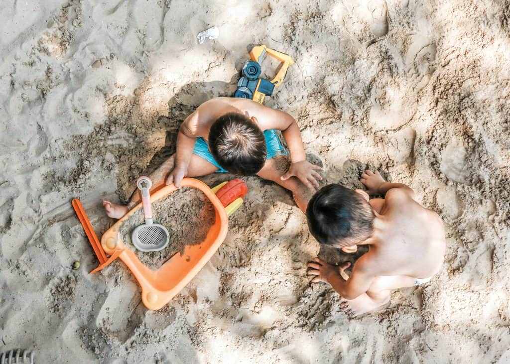 Kids Playing in Sand